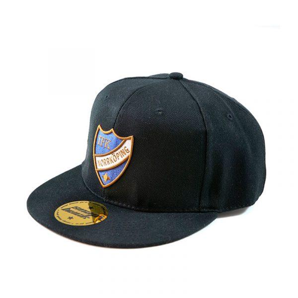 Keps med IFK Norrköpings emblem